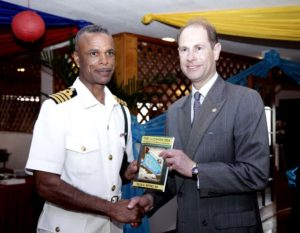 Prince Edward Earl of Wessex presented with book by Capt. Tellis A. Bethel, Commander Defence Force (Acting). Nassau, Bahamas