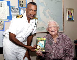 Capt. Tellis A. Bethel presents book The Lucayan Sea to Sir Durwood Knowles